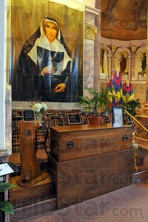 At rest: St. Mother Theodore Guerin's casket in the Church of teh Immaculate Conception and its stand are made from walnut. The trees were harvested on the grounds of St. Mary-of-the-Woods over 50 years ago.