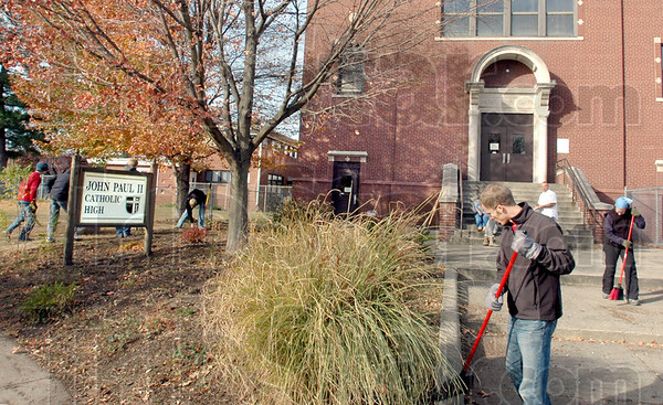 Day of Service: Rose-Hulman students do some landscaping clean-up Saturday morning at John Paul II Catholic High School as part of their Day of Service participation.