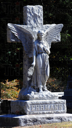 Enduring: The final resting place of Max Ehrmann is watched over by this angel and cross in Highland Lawn cemetery.