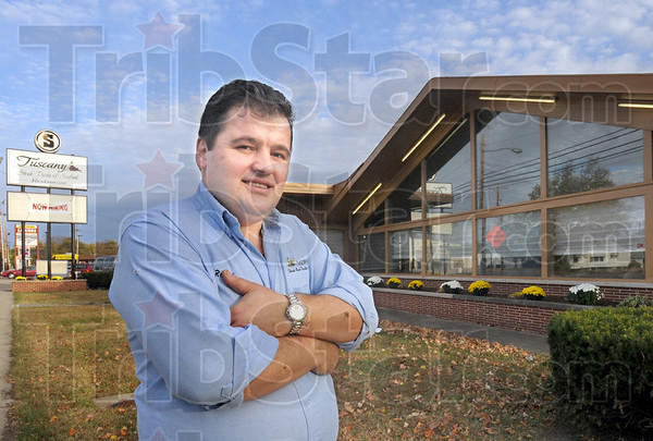Owner: Tuscany Restaurant owner Rocky Seleimoski stands proudly outside his new eastside business Thursday afternoon.