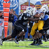 work: Sycamore defenders CJ Cook(55) and Calvin Burnett(5) haul down Jackrabbit wide recieverTyrel Kool(2) in second quarter action. Burnett later sealed the ISU win with a late interception.