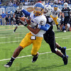 Stopped: Jackrabbit recieverAaron Rollin is tackled by ISU defender Calvin Burnett after a completed pass.