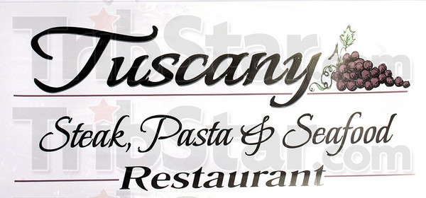 Sign detail: Detail photo of Tuscany Restaurant sign.