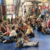 Anti-bullying: Ellen Richter (R) talks with a group of children at the Terre Haute Children's Museum about bullying.