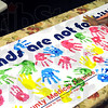 Hands: Children use colored paints and the palms of their hands to decorate a large banner during Wednesday's anti-bullying program at the Terre Haute Children's Museum.