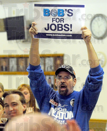 Bob for Bob: Bob Flott holds a placard supporting Bob Heaton during Wednesday's rally at the VFW Post 972.