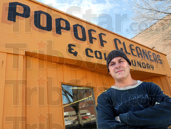 Closing: Tim Popoff stands outside his Wabash Avenue business Wednesday afternoon. He's closing the business soon.