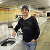 Closing: Tim Popoff inside his Popoff Cleaners location at 1519 Wabash Avenue. The business will soon close.