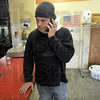Last call: Tim Popoff answers the phone in his eastside business Wednesday. He's soon to close the long-time Popoff Cleaners at 1519 Wabash Ave.