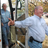 Bus tour: Larry Bucshon steps of Mike Pence's (left) bus as they arrive in Terre Haute to stump for Bob Heaton Wednesday afternoon.