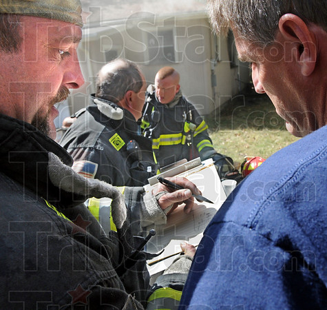 Drawing: Terre Haute fire department Capt. Jeff Stevens draws an interior layout of a house for fire investigator Jeff Hodges just minutes after firefighters doused the flames at 2310 S. 19th Street Wednesday afternoon.