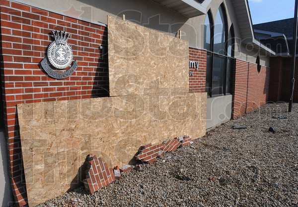 Worse than it looks: The exterior of the Salvation Army building in the 200 block of South 8th street Is boarded up after a weekend accident.