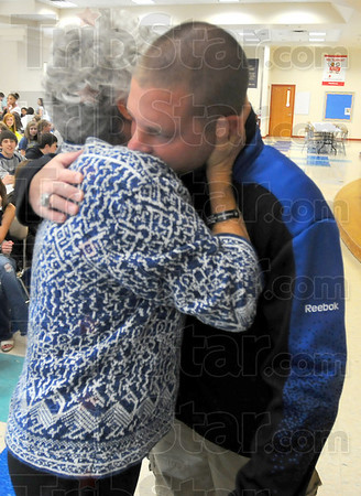 Support: Dona Griffin gives a hug to former Marine Josh Bleill before he gave his talk to a group of Honey Creek Middle School students Monday afternoon.