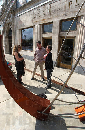 Looking them over: Lisa Petrulis, curator of the Swope Museum and Brian Whisenhuit, its director,chat with Mary Cramer of Art Spaces in front of the Museum Monday afternoon. Cramer and Petrulistion of the different sculptures. Cramer said they were in very good shape structurally.
