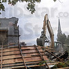 Bedino demo: An excavator operator uses his machine to demolish the former Bedino Chapel at 6th and Poplar Streets Monday afternoon. The facility also served as a former fraternity house.