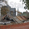 Funeral for a home: The former Bedino funeral home/fraternity house located at 6th and Poplar Streets is  in the process of being demolished late Monday afternoon.