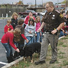 Good Doggy: Clay County Sheriff's Deputy Brian Swearingen leads K-9 partner Dayk to meet Staunton Elementary fifth-graders prior to a canine demonstration Monday outside the Clay County Justice Center.  Swearingen and Dayk demonstrated suspect apprehension and an obstacle course as part of Red Ribbon Week activities.