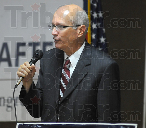 Dem: Gary Rider, candidate for prosecutor, takes his turn at the microphone at the Labor Temple Monday evening.