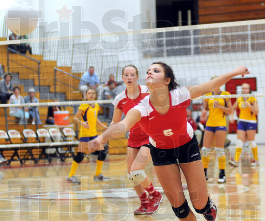 Spread your wings: Woodrow Wilson's #5, Mandee Eberle reaches for a ball hit past her during match action against Otter Creek Monday evening.