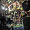 Behind the scenes: Photographer John Bragg gives instructions to the children playing in the tree house at the Terre Haute Children's Museum Monday morning.