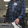 Backup: Vigo County election Tech Sherman Wilkins watches a polling machine print out its tabulations during a test run .