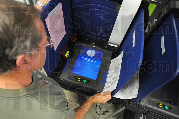 Checking it out: Vigo County Election Technician Tony Leturgez puts an ADA voting machine through its paces during a trial run Tursday afternoon.