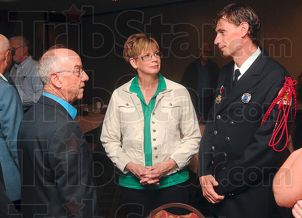 """Tribune-Star/Joseph C. Garza<br /> Thanks from the club: Exchange Club President Abe Miller talks with Terre Haute Fire Department Firefighter William """"Billy"""" Roberts, right, and his mother, Nancy Roberts, before the awards ceremony Tuesday at the Holiday Inn."""