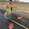 Open for business: Butch Crossley, supervisor for Wabash Valley Asphalt, removes barricades from the on ramp of the 641 bypass at McDaniel Road just after noon Tuesday.