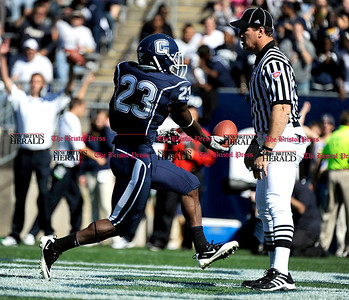 10/2/2010 Mike Orazzi | Staff UConn's Jordan Todman (23) scores an early TD during Saturday's win over Vanderbilt.