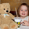 "Bizzy Bear goes to Mason's for Sunday brunch.  Anna is ""sharing"" her very yummy chocolate milk, after much coaxing."