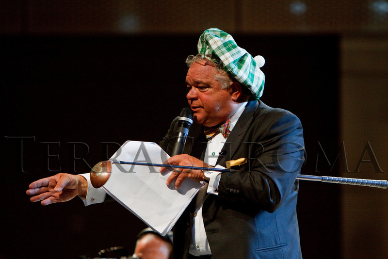 """(Denver, Colorado, Oct. 2, 2010)<br /> Peter Kudla auctions a golf package.  The """"Be Beautiful Be Yourself Jet Set Fashion Show 2010,"""" benefiting the Global Down Syndrome Foundation, at Hyatt Regency Denver at the Colorado Convention Center in Denver, Colorado, on Saturday, Oct. 2, 2010.<br /> STEVE PETERSON"""