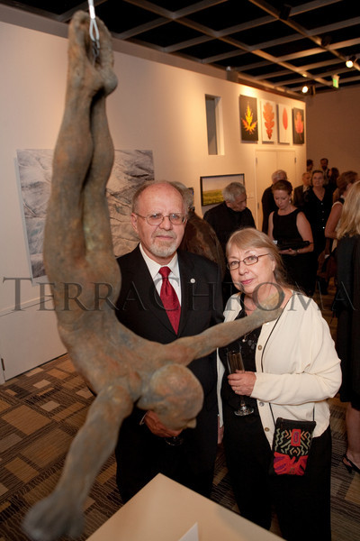 "(Denver, Colorado, Oct. 16, 2010)<br /> Bill Starke and his wife, Judy, with his artwork, ""Skydiver,"" a cast and patinated aluminum sculpture.  ""Salon du Musée,"" benefiting the Denver Art Museum, at the Denver Art Museum in Denver, Colorado, on Saturday, Oct. 16, 2010.<br /> STEVE PETERSON"