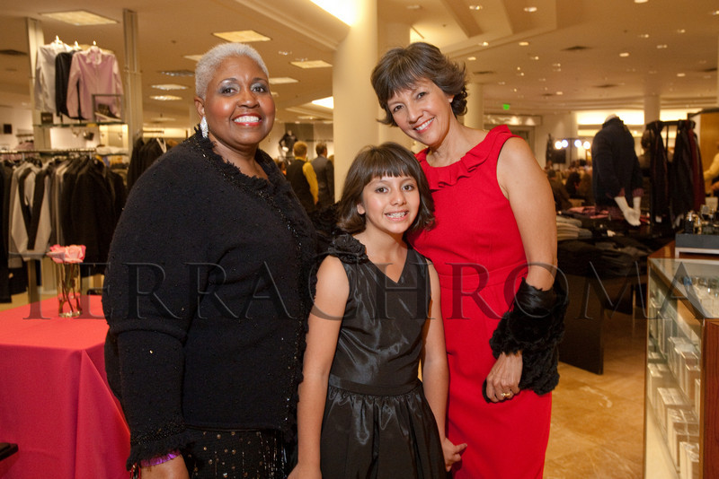 "(Denver, Colorado, Oct. 21, 2010)<br /> Lagressa Munnerlin with Hope and Judy Montero.  ""Key to the Cure,"" a women's cancer program benefit hosted by the Denver Health Foundation, at Saks Fifth Avenue Cherry Creek in Denver, Colorado, on Thursday, Oct. 21, 2010.<br /> STEVE PETERSON"