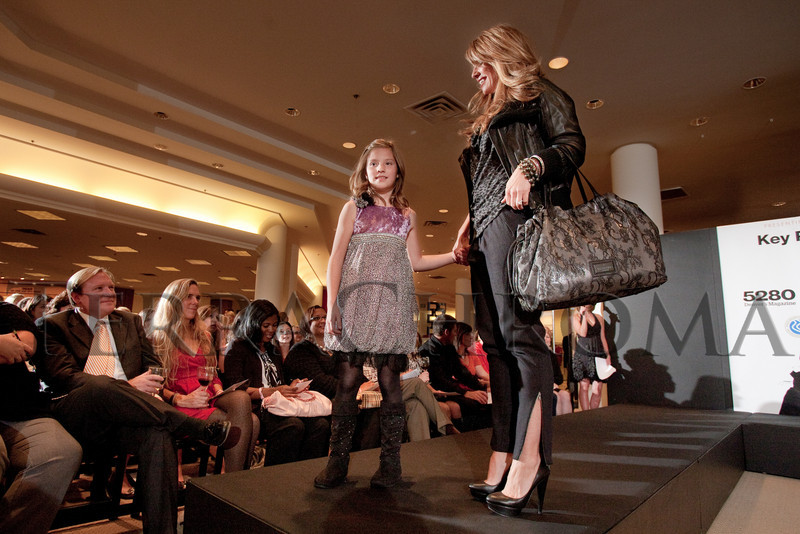 "(Denver, Colorado, Oct. 21, 2010)<br /> Kamryn and Debbie Sakic.  ""Key to the Cure,"" a women's cancer program benefit hosted by the Denver Health Foundation, at Saks Fifth Avenue Cherry Creek in Denver, Colorado, on Thursday, Oct. 21, 2010.<br /> STEVE PETERSON"