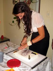 Olivia slices her cake.