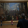 I actually made it into a couple pictures.  The Louvre had many huge paintings like this.