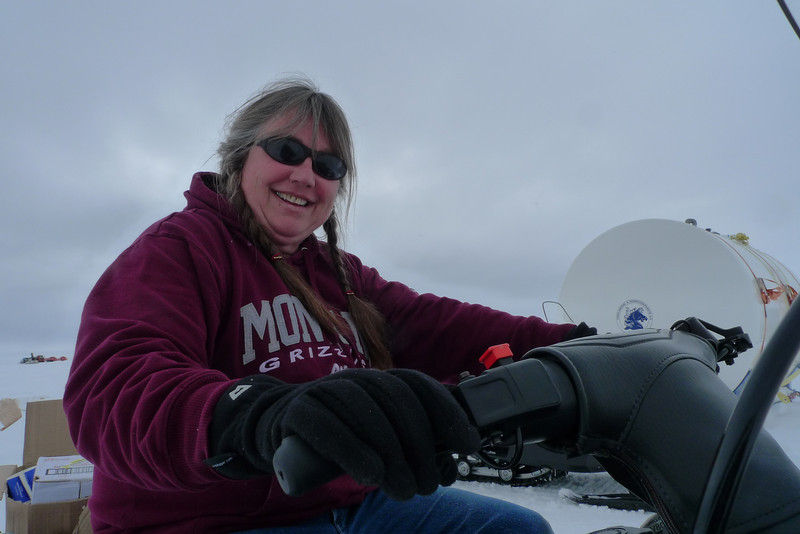 Sarah riding a snowmobile<br /> <br /> Photo: Sepp Kipfstuhl