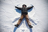 The snow provides a perfect playing ground-here making a snow angel <br /> <br /> Photo: Tim Burton