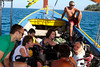 A boatload of divers listens to a briefing from Monja on our way out to Koh Weo.