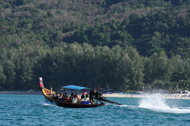 Longtail boats are the primary way to get around on the ocean in Thailand.