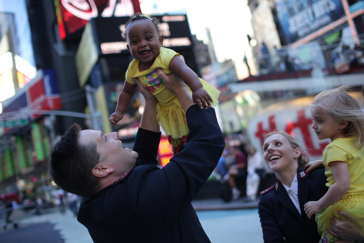 NEW YORK, NEW YORK - SEPT 14, 2010:  Captains William M. & Annalise R. Francis with their daughter Callie  (blond) and adopted daughter Savannah at their home in the Salvation Army regional headquarters near Times Square in Manhattan.   (Photo by J Carrier/Getty Images for Priority Magazine)