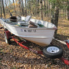 SO DOUG GOES LOOKING FOR THE BOAT IN THE WOODS...WHADDAYAKNOW...HERE IT IS NEAR MY DEER STAND.  DOUG BRINGS THE BOAT BACK TO THE BEACH WHERE YOU COULDN'T SPELL THE KIND WORDS GLENN HAD FOR US.........WOULDN'T BE SURPRISED TO FIND MY BULLDOZER ON TOP OF MY MACHINE SHED SOMEDAY???