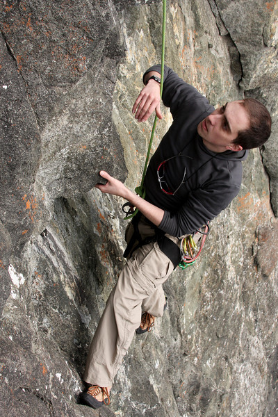 Ryan works his way up a tough 5.10, searching for holds on the face.