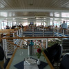 our seats (forground) - the boat was fully booked but most people stayed outside above deck and along the railings for a better view.