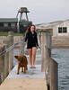 Isabel walking along the pier with Rogue