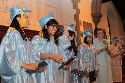 Graduates are presented their diplomas during Nora Cronin Presentation Academy's first graduation on Saturday, June 12, 2010 at Calvary Presbyterian Church in Newburgh, NY. Hudson Valley Press/CHUCK STEWART, JR.