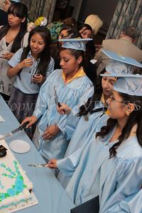 Nora Cronin Presentation Academy's first graduating class cut a cake in dinning hall of Calvary Presbyterian Church on Saturday, June 12, 2010 in Newburgh, NY. Hudson Valley Press/CHUCK STEWART, JR.