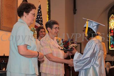Sr. Yliana Hernandez, PBVM, Principal, presents diplomas to Nora Cronin Presentation Academy graduates on Saturday, June 12, 2010 at Calvary Presbyterian Church in Newburgh, NY. Hudson Valley Press/CHUCK STEWART, JR.