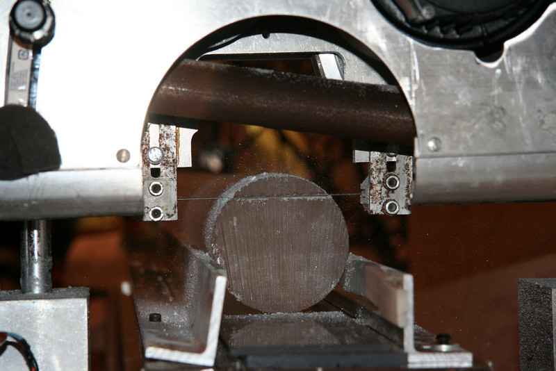 The ice is cut for various measurements; here the piece for physical properties is cut (top piece)<br /> <br /> Photo: Marie Kjaergaard