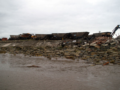 View from the beach at Ayr Harbour of Scrap HAA's being broken up.